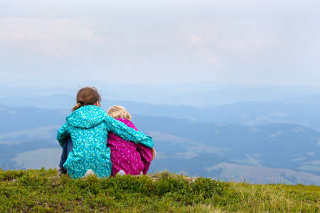 tourist girls and mountain views  photo