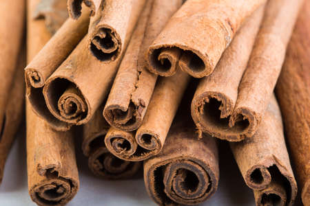 cannelle: several cinnamon sticks on a white background  Stock Photo