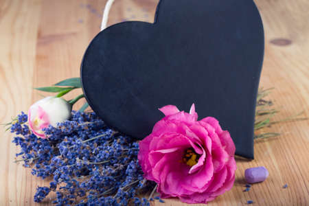 board as heart shape for records with flowers  photo