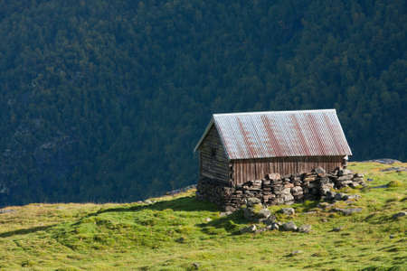 rural mountain cabin on a hill high at the mountains