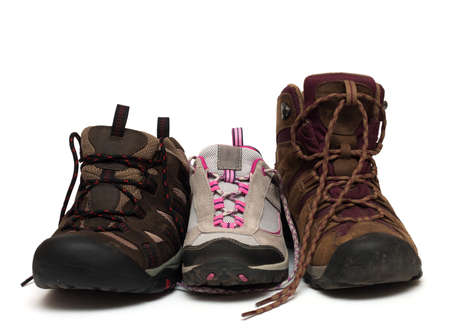 three trekking shoes for the family: father, mother and child photo
