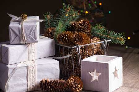 Christmas backgrounds. Gifts and Christmas decor on the wooden background. photo