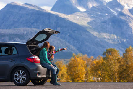 cars road: Mom and daughter - tourist girls and mountain views