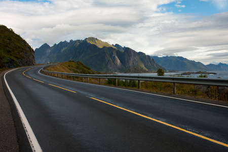 winding road: view of an empty winding road at the Lofoten islands Stock Photo