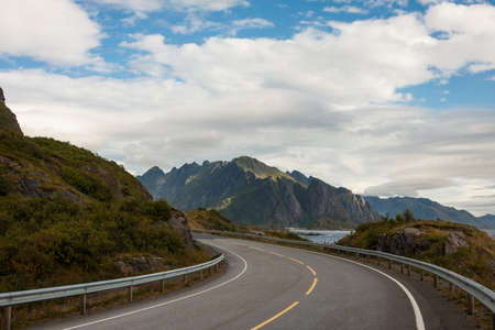 guardrail: view of an empty winding road at the Lofoten islands Stock Photo