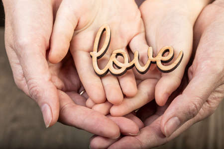 hands holding word love photo