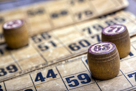 card game: old wooden lotto barrels and game cards Stock Photo