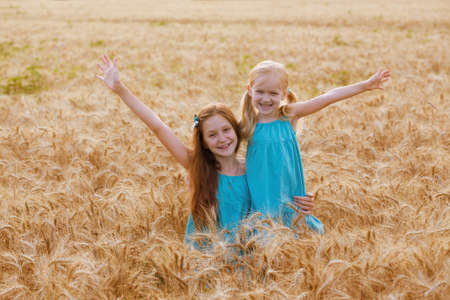 joys: young girls joys on the wheat field