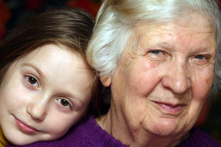 portrait of a grandmother and granddaughter, close-up photo