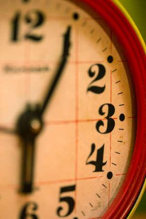 analog clock: old rusty alarm clock face close up