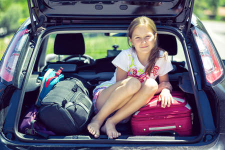 car trunk: young  girl portrait at the car trunk