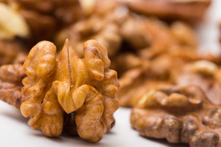 shelled: group of shelled walnuts close up background Stock Photo