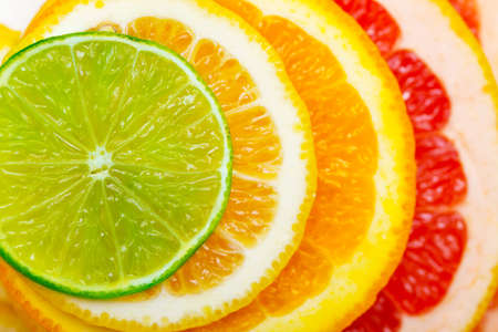citrus background - lime, lemon, orange, grapefruit