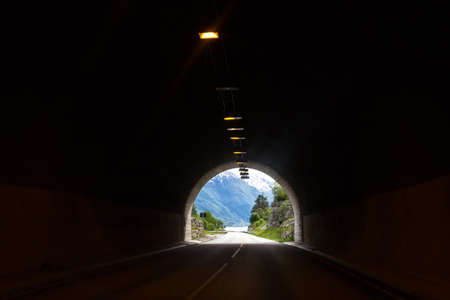 tunnel view: view from the tunnel of the mountains and lake. Norway