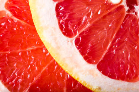 sweet food: background made with a heap of sliced grapefruits Stock Photo