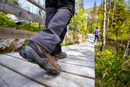 hiking boots: hiking boots close-up. tourist walking on the trail. Norway Stock Photo