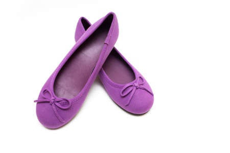 purple shoes: Childrens bright purple shoes on a  white background Stock Photo