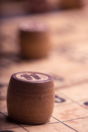 lotto: old wooden lotto barrels and game cards Stock Photo