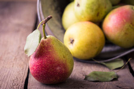 obsolete: pears lying on an old obsolete wooden table