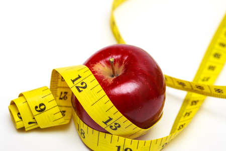 weight control: apple and measuring tape on a white background Stock Photo