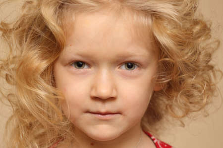crinkly: portrait of smiling curly little girl indoors