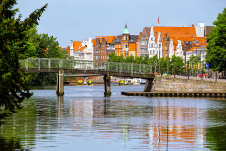 trave: bridge and houses on the bank of the river Trave, Lubeck Stock Photo