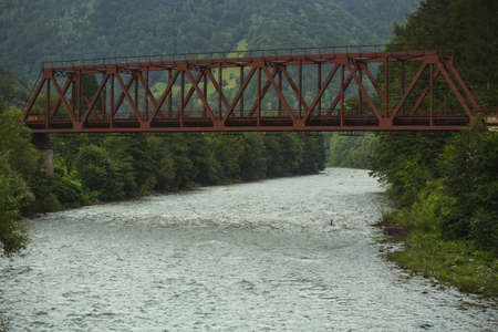 rapid steel: Metal railway bridge over a mountain river in Carpathian mountains, Ukraine