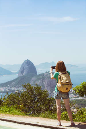 pao: girl tourist with a backpack on the background Rio de Janeiro. view from Pao de Acucar Stock Photo