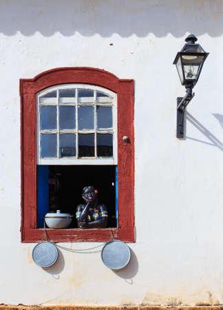 souvenir traditional: traditional brazilian souvenir girl at the country house window