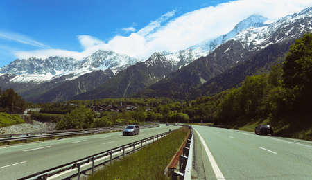 autobahn: straight autobahn going to the mountains at the sunny day