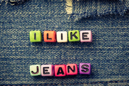 i like: cubes with letters I like jeans on a jeans background