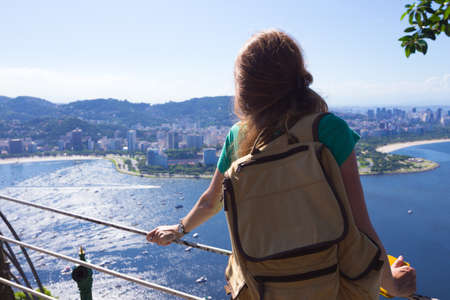 pao: girl tourist  looks at Rio landscape from the Pao do Asucar viewpoint