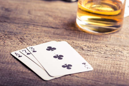 ace: three, seven, ace playing card combination on a wooden table
