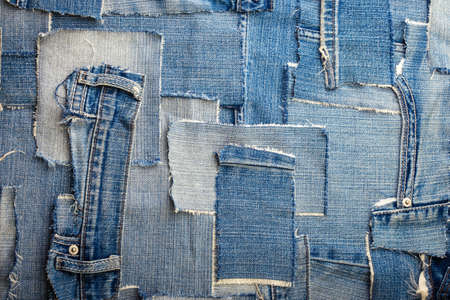 clout: background made of old jeans rags close up