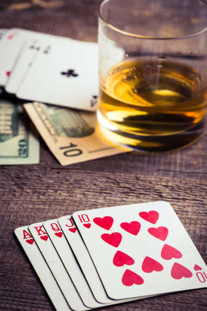 combination: flush royal combination cards lying on a wooden table