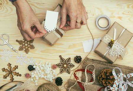 christmas element: scrapbook background. christmas - girl packs gift