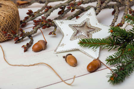 Christmas Background- Christmas toy, acorns, tree branch