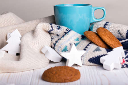 table scraps: cup of coffee with oat cookies and Christmas decorations