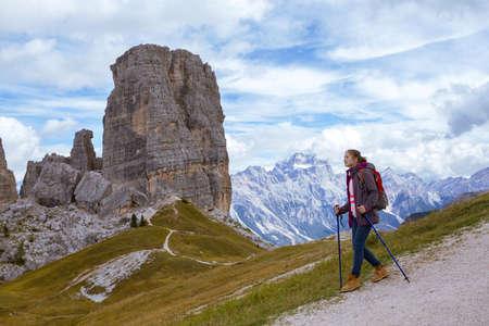 torri: girl hiker at the mountains Dolomites, Italy. Cinque Torri