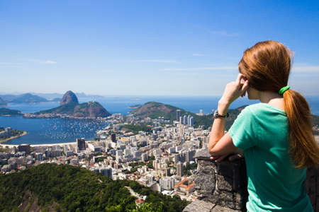 pao: girl tourist  looks at Rio landscape and the Pao do Asucar