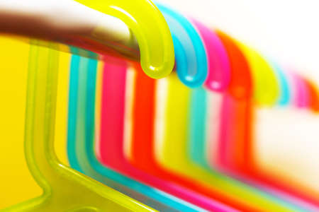 multicolored hangers on white background with small depth of field