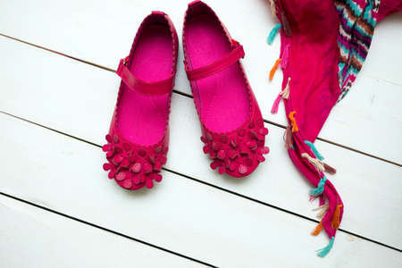 pink shoes: Childrens bright pink shoes and scarf on a white background  Stock Photo