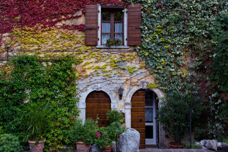a beautiful facade of an ancient house  in a small town Tremosine. Italy.