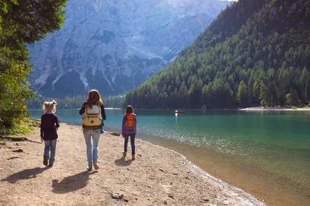 family. mother and her daughter walking around the Braies lake, Dolomites Italy