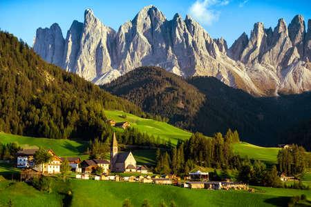 famous beautiful church Santa Maddalena at the Dolomites,  Italy.