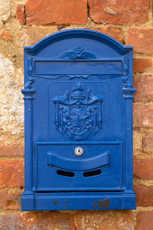 letterbox: blue letter-box on a wall