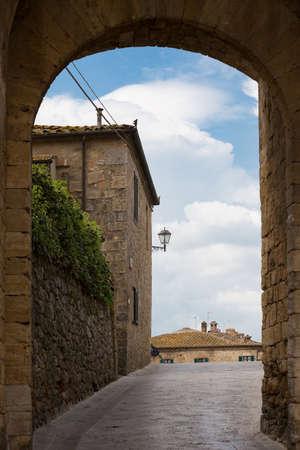 stone gates at the entry to Monteriggioni old town Stock Photo