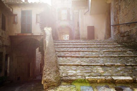 View of the streets in the old  famous tuff city of Sorano, province of Siena. Tuscany, Italy Stock Photo