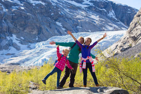 jostedalsbreen: mother and daughters on a Nigardsbreen glacier at Norway
