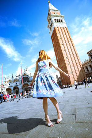 Beautiful happy girl whirls in the plaza of San Marco, venice. Italy Stock Photo